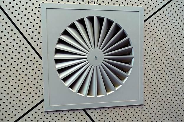 Grey exhaust fan in ceiling