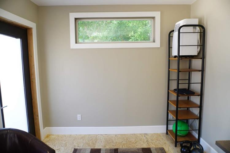 Internal view of backyard office shed with earth-color painted walls and treated OSB flooring, from Mr Money Mustache.