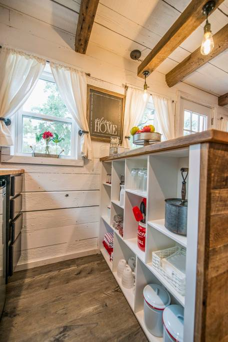 A detailed look at the very handy storage options (with lots of shelves) that is built into the back of the breakfast bar.