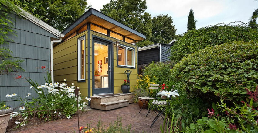Modern-Shed's small shed which can be effectively used as a backyard studio; it has lots of windows for natural light, and inside lights to produce a well-lit (and easy to work in) space.