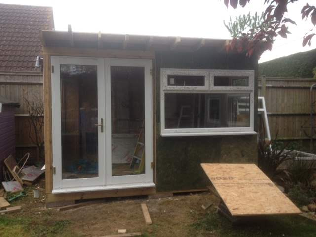 A work in progress photo of Roger Perkin's garden office shed, with UPVC doors and windows added. Roof and internals still need finishing off.