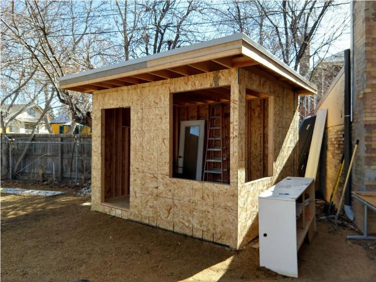 OSB wall sheathing on the front and side of the backyard office shed, from Mr Money Mustache.