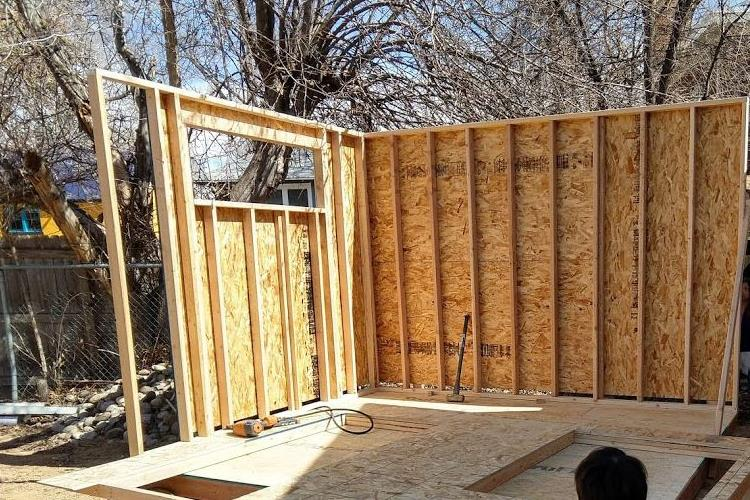 Photo of wall framing with a window towards the top, and cripples underneath for support, from Mr Money Mustache.